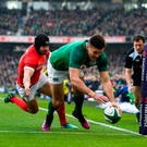 24 February 2018; Jacob Stockdale of Ireland scores his side's first try despite the best efforts of Leigh Halfpenny of Wales during the NatWest Six Nations Rugby Championship match between Ireland and Wales at the Aviva Stadium in Lansdowne Road, Dublin. Photo by Brendan Moran/Sportsfile