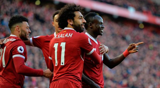 Soccer Football - Premier League - Liverpool vs West Ham United - Anfield, Liverpool, Britain - February 24, 2018 Liverpool's Sadio Mane celebrates scoring their fourth goal with team mates. REUTERS/Peter Powell