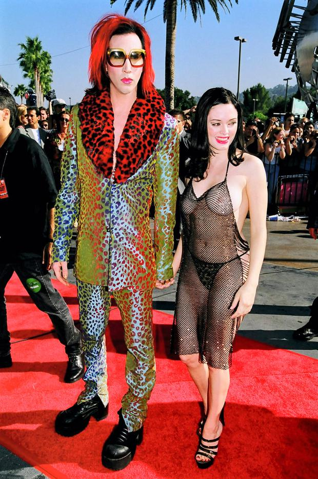 Rose McGowan with Marilyn Manson, in controversial chain dress