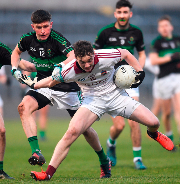 Slaughtneil's Brain Cassidy in action against Colin O'Brien of Nemo Rangers at O'Moore Park. Photo: Eóin Noonan/Sportsfile