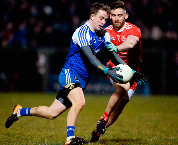 Monaghan'sJack McCarron battles with Tyrone's Padraig Hampsey. Photo: Oliver McVeigh/Sportsfile