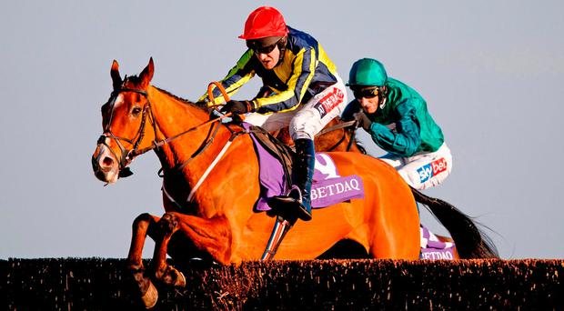 Master Dee, with Barry Geraghty up, jumps the last en route to winning the Betdaq Handicap Chase. Photo: John Walton/PA