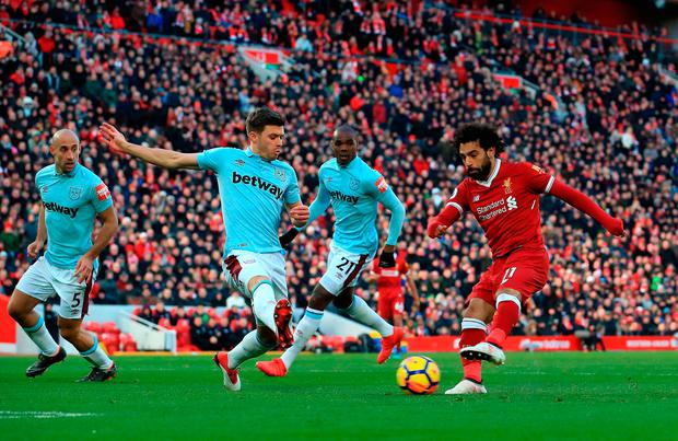 Liverpool's Mohamed Salah scores his side's second goal of the game against West Ham United during yesterday's match at Anfield. Photo: Peter Byrne/PA