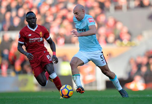 West Ham United's Pablo Zabaleta in action with Liverpool's Sadio Mane. Photo: Peter Powell/Reuters