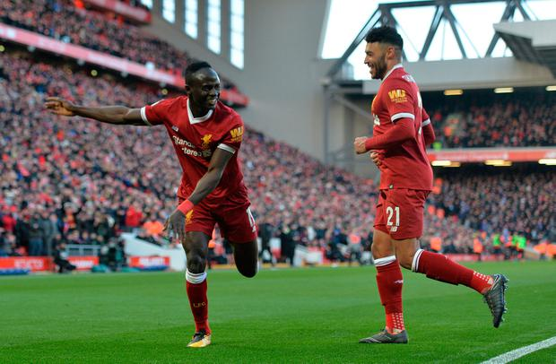 Liverpool's Sadio Mane celebrates scoring his side's fourth goal. Photo: Peter Powell/Reuters