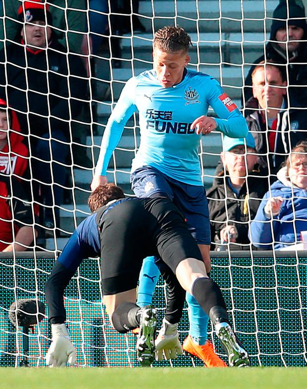 Newcastle United's Dwight Gayle scores his side's first goal with a backheel. Photo: Adam Davy/PA