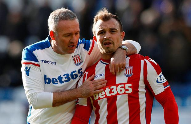 Stoke City manager Paul Lambert with Xherdan Shaqiri after the match. Photo: Darren Staples/Reuters