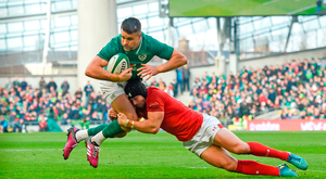 Ireland's Conor Murray is tackled by Leigh Halfpenny during yesterday's game. Photo: David Fitzgerald/Sportsfile