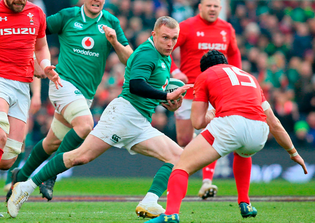 Ireland's wing Keith Earls is tackled by Wales' full-back Leigh Halfpenny Photo: Getty