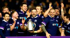 John Barclay of Scotland holds aloft the Calcutta Cup and leads the celebrations with the team after victory Photo: Getty