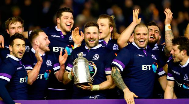 John Barclay of Scotland holds aloft the Calcutta Cup and helping Scotland  to a victory over