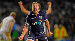 Stuart Hogg of Scotland celebrates Scotland's shock victory over England at Murrayfield yesterday. Photo: Shaun Botterill/Getty
