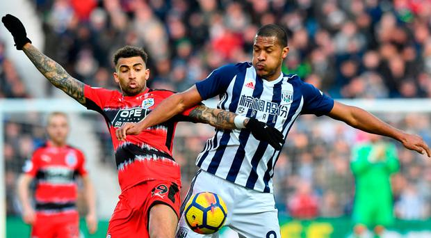Huddersfield Town's Danny Williams and West Bromwich Albion's Salomon Rondon compete for possession Photo: PA