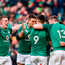 Dan Leavy, left, of Ireland runs in to celebrate with team mates after Jacob Stockdale scored their side's fifth try