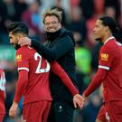 Liverpool manager Jurgen Klopp, Emre Can and Virgil van Dijk celebrate after the match