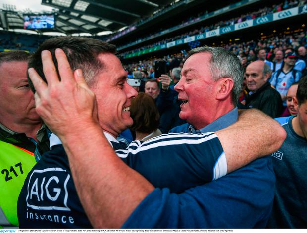 Dublin captain Stephen Cluxton is congratuled by John McCarthy after 2017 win