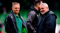 Ireland head coach Joe Schmidt, left, speaks with Wales head coach Warren Gatland