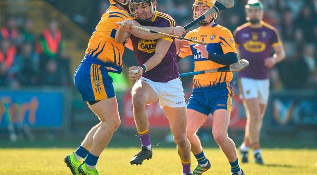 Jack O'Connor of Wexford in action against Jason McCarthy and Colm Galvin of Clare