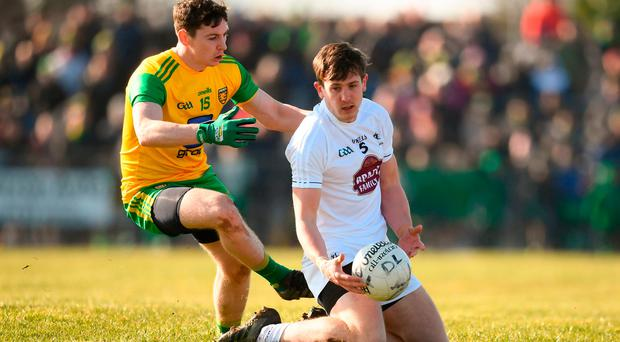 Cian O'Donoghue of Kildare in action against Jamie Brennan of Donegal