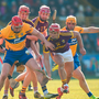 Lee Chin, centre, Paul Morris and Paudie Foley of Wexford in action against Niall Deasy, left, and Jason McCarthy of Clare