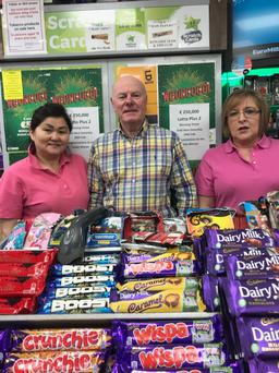 Store owner of Centrepoint Newsagent, Joe Sweeney (centre) celebrates with staff after selling a winning Lotto Plus 2 top prize winning ticket worth €250,000.