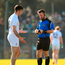Eoin Doyle of Kildare appeals to referee David Gough before receiving a yellow card