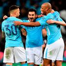 Manchester City's Ilkay Gundogan (centre), Manchester City's Nicolas Otamendi (left) and Manchester City's Vincent Kompany (right) celebrate after the final whistle