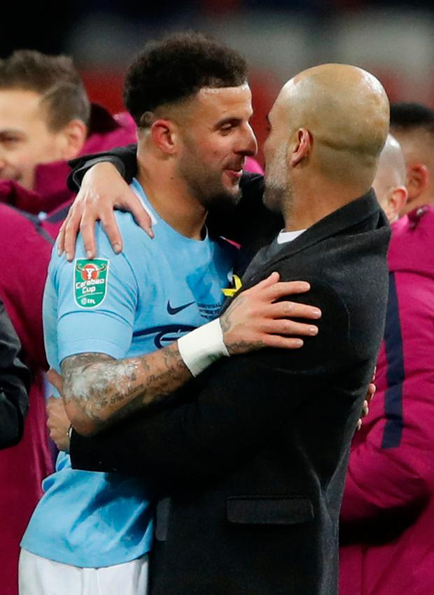 Soccer Football - Carabao Cup Final - Arsenal vs Manchester City - Wembley Stadium, London, Britain - February 25, 2018 Manchester City manager Pep Guardiola celebrates with Kyle Walker after the match Action Images via Reuters/Carl Recine EDITORIAL USE ONLY. No use with unauthorized audio, video, data, fixture lists, club/league logos or