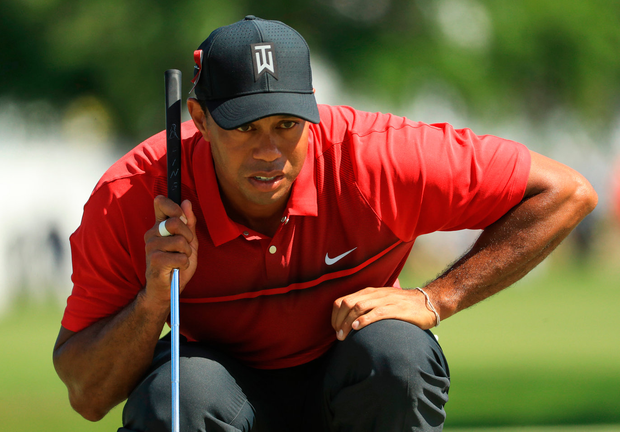 Tiger Woods lines up a putt at the fourth hole after yesterday's final round of the Honda Classic. Photo: Getty Images
