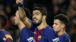 Barcelona's Luis Suarez celebrates scoring their fourth goal. Photo: Reuters