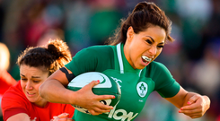 Sene Naoupu breaks the tackle from Wales' Rhiannon Parker as she runs in to score Ireland's third try at Donnybrook. Photo: Sportsfile