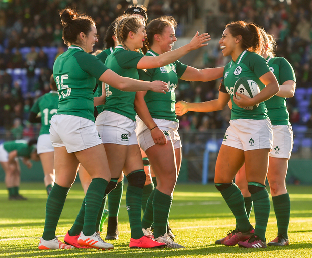 Sene Naoupu of Ireland is congratulated by team mates after scoring her side's third try. Photo: Sportsfile