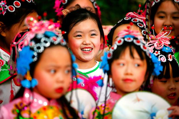 Kelly Chen (6), from Tallaght, smiles during a performance as part of the Dublin Chinese New Year Festival in the CHQ building. Photo: Gerry Mooney