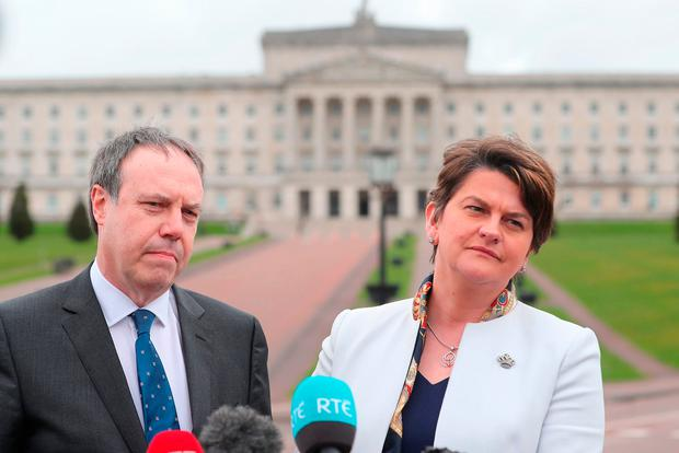 DUP leader Arlene Foster and deputy leader Nigel Dodds speaking to the media outside Stormont. Photo: PA