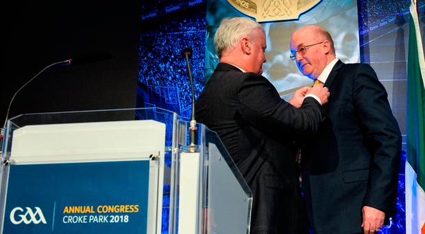 Aogán Ó Fearghail presents the incoming president John Horan with the Presidential Medal during the annual Congress at Croke Park on Saturday. Photo: Sportsfile