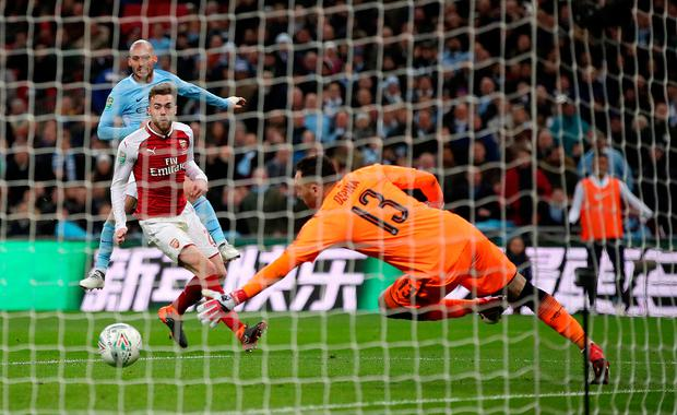 Manchester City's David Silva (back) scores his side's third goal of the game. Photo: PA Wire