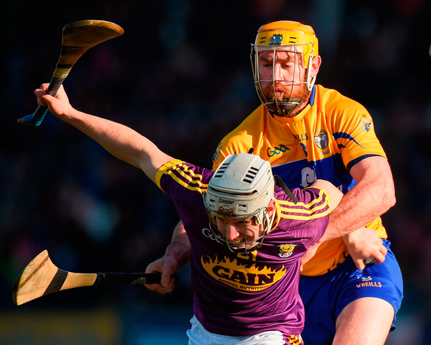 Cathal Dunbar of Wexford in action against Gearoid O'Connell of Clare Photo: Sportsfile