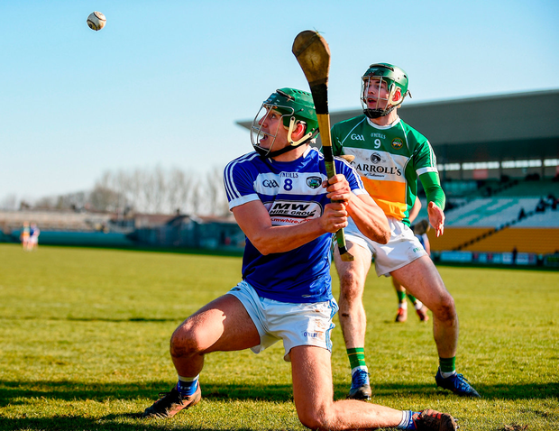 James Ryan of Laois in action against Tommy Geraghty of Offaly Photo: Sportsfile