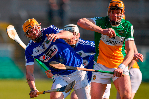 Charles Dwyer of Laois in action against Colin Egan of Offaly Photo: Sportsfile
