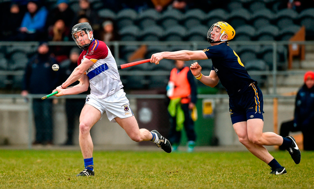Tony Kelly of UL in action against Daire Grey of DCU Photo: Sportsfile
