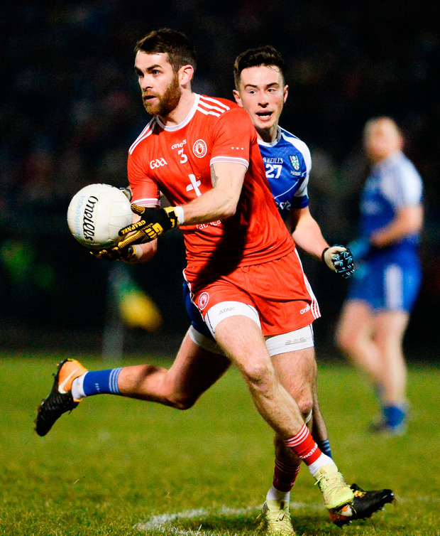 Ronan McNamee of Tyrone is challenged by Shane Carthy of Monaghan Photo: Sportsfile