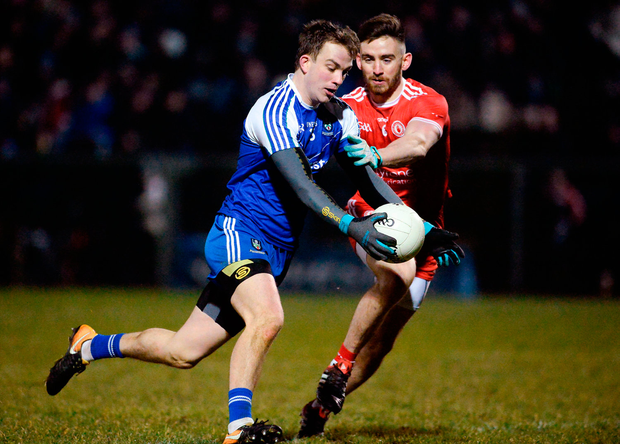 Jack McCarron of Monaghan is tackled by Tyrone's Padraig Hampsey Photo: Oliver McVeigh/Sportsfile