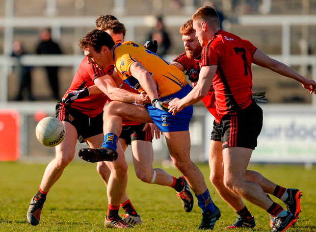 Alan Sweeney of Clare is surrounded Photo: Sportsfile
