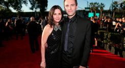 Courteney Cox (L) and songwriter Johnny McDaid attend The 57th Annual GRAMMY Awards at the STAPLES Center on February 8, 2015 in Los Angeles, California. (Photo by Christopher Polk/WireImage)
