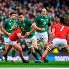 James Ryan of Ireland is tackled by Ross Moriarty of Wales
