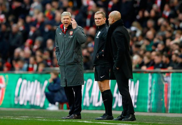 Arsenal manager Arsene Wenger clashes with Manchester City manager Pep Guardiola as fourth official Graham Scott looks on