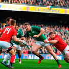 Chris Farrell of Ireland is tackled by Samson Lee of Wales