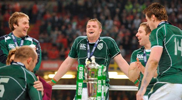 Ireland players, from left, Stephen Ferris, Jamie Heaslip, Tomas O'Leary and Tommy Bowe wait for captain Brian O'Driscoll to lift the RBS Six Nations trophy after Grand Slam glory in 2009. More the same this weekend? Picture credit: Brendan Moran / SPORTSFILE