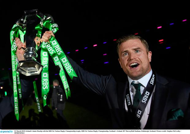 21 March 2015; Ireland's Jamie Heaslip with the RBS Six Nations Rugby Championship trophy, but now he is enjoying Ireland's success as a spectator. Picture credit: Stephen McCarthy / SPORTSFILE