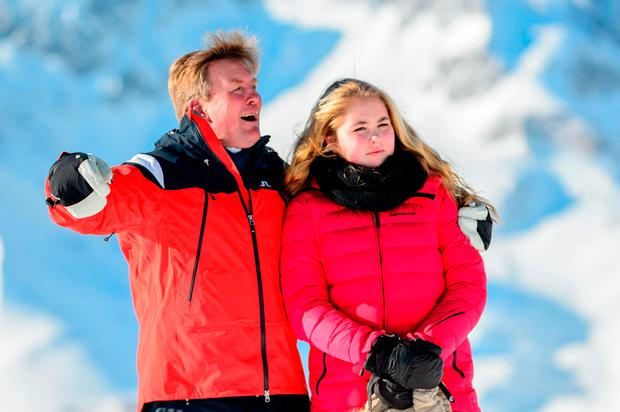 (L-R) King Willem-Alexander of the Netherlands and Princess Catharina-Amalia of the Netherlands pose at a photocall during their ski holidays, in Lech am Arlberg, Austria, on February 26, 2018. / AFP PHOTO / APA / DIETMAR STIPLOVSEK / Austria OUTDIETMAR STIPLOVSEK/AFP/Getty Images